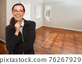Woman With Pencil In Empty Room of New House 76267929