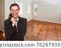 Woman With Pencil In Empty Room of New House 76267930