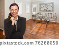 Woman With Pencil In Empty Room of New House with Couch and Table Drawing on Wall 76268059