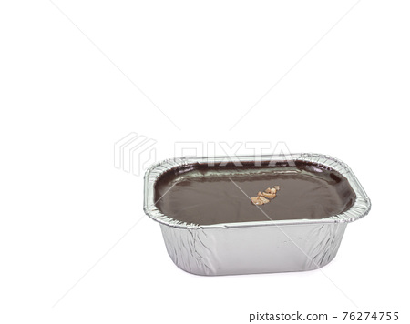 Chocolate fudge cake, a close up of homemade mousse brownie cake in aluminum foil cup isolated on white background. 76274755