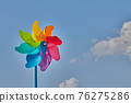 Left Frame Rainbow Pinwheel On Blue Sky Background 76275286