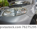 Car Headlight and Car Engine in Garage 76275295