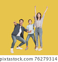 Happy young family with  child standing together 76279314