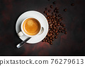 Coffee and roasted beans on dark background 76279613