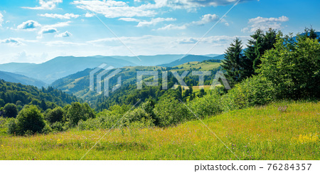 countryside landscape in summer. beautiful nature scenery with meadows on the hills rolling in to the distant valley. wonderful sunny weather 76284357