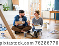 Couple eating lunch indoors at home, relocation, diy and food delivery concept. 76286778