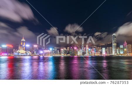 Hong Kong downtown skyline across Victoria harbor at night, Hong Kong, China. 76287353