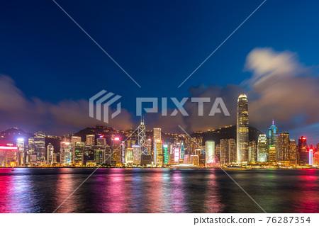 Hong Kong downtown skyline across Victoria harbor at night, Hong Kong, China. 76287354