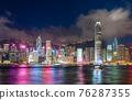 Hong Kong downtown skyline across Victoria harbor at night, Hong Kong, China. 76287355