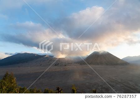Beautiful Panoramic sunset view of Bromo active volcano in Bromo Tengger Semeru National Park,  East Java, Indonesia 76287357