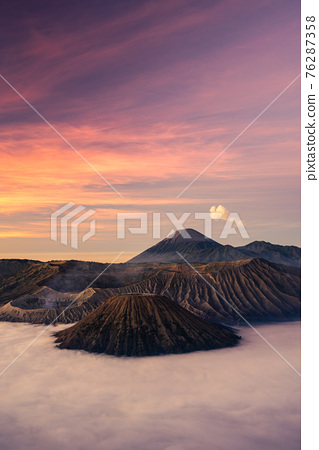 Beautiful sunrise at Bromo volcano mountain in East Java, Indonesia surrounded by morning fog. 76287358