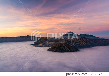 Bromo volcano mountain at sunrise in East Java, Indonesia surrounded by morning fog. 76287360