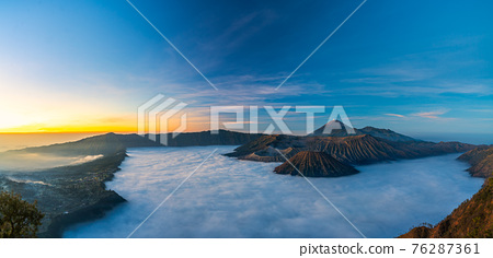 Bromo volcano mountain at sunrise in East Java, Indonesia surrounded by morning fog. 76287361