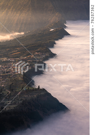 Cemoro Lawang village at Bromo volcano mountain in, East Java, Indonesia with beautiful sunrise and sea of fog 76287362