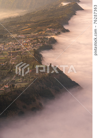 Cemoro Lawang village at Bromo volcano mountain in, East Java, Indonesia with beautiful sunrise and sea of fog 76287363