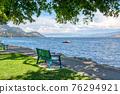 Recreation area along a waterfront walkway on Okanagan lake 76294921