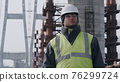 Male contractor on bridge construction site 76299724