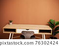 Modern empty wooden table and green plant 76302424