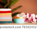 Stack of fresh towels on table in bathroom 76302432