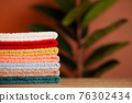 Stack of fresh towels on table in bathroom 76302434