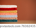 Stack of fresh towels on table in bathroom 76302435