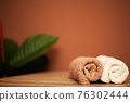 Towels on the table in the spa salon 76302444