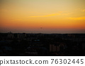 Airplane take off over the panorama city at twilight scene 76302445