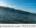 Breaking Waves and spray, white water and light reflected on the surface of the water 76303190