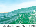 Breaking Waves and spray, white water and light reflected on the surface of the water 76303198