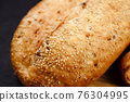 Freshly baked sliced wheat bread on cutting board 76304995