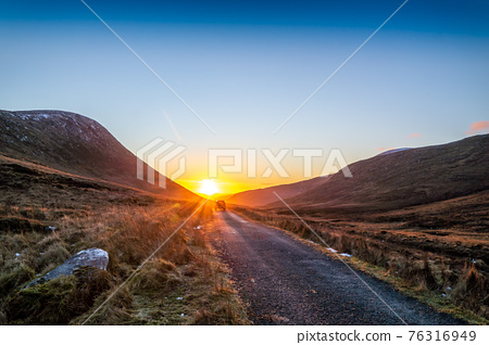 Winter sunset at the Glenveagh National Park in County Donegal - Ireland 76316949