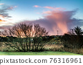 Stunning clouds above peatbog in County Donegal - Ireland 76316961