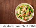 Caesar salad with chicken, top shot with a place for text 76317969