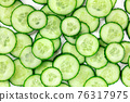 Cucumber background, overhead flat lay shot of cucumber slices 76317975