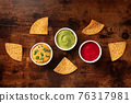 Nachos and various dips, overhead flat lay shot 76317981