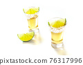 Tequila shots with lime slices on white 76317996