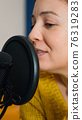Entertainment blogger broadcasting from home studio 76319283