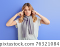 Thoughtful female concentrated on thoughts, isolated on blue background 76321084