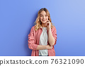 attractive young female in casual outfit stand looking at camera 76321090