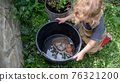 Top view of small girl playing with frog outdoors in summer. 76321200