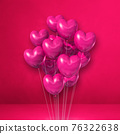Heart shape balloons bunch on a pink wall background 76322638