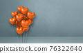 Orange heart shape balloons bunch on a grey wall background. Horizontal banner. 76322640