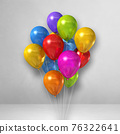 Colorful balloons bunch on a white wall background 76322641