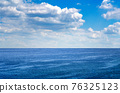 Perfect blue sky with clouds and water of the sea 76325123