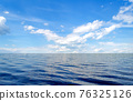 Perfect blue sky with clouds and water of the sea 76325126