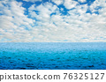 Perfect blue sky with clouds and water of the sea 76325127