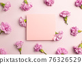 Memo pad with carnation flowers on pink background. flat lay, top view, copy space 76326529