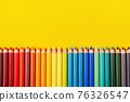 Beautiful color pencils on the yellow background. 76326547