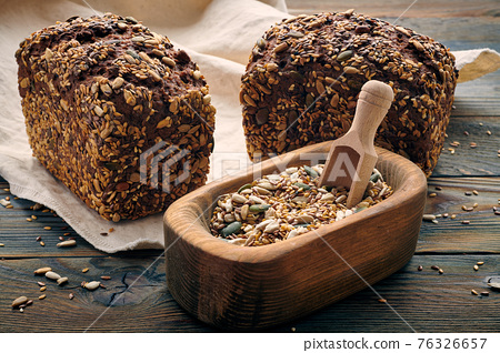 Homemade bread on dark wooden table 76326657