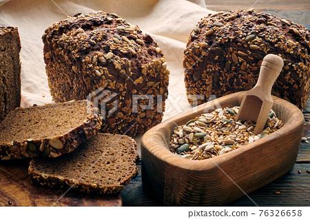 Homemade bread on dark wooden table 76326658